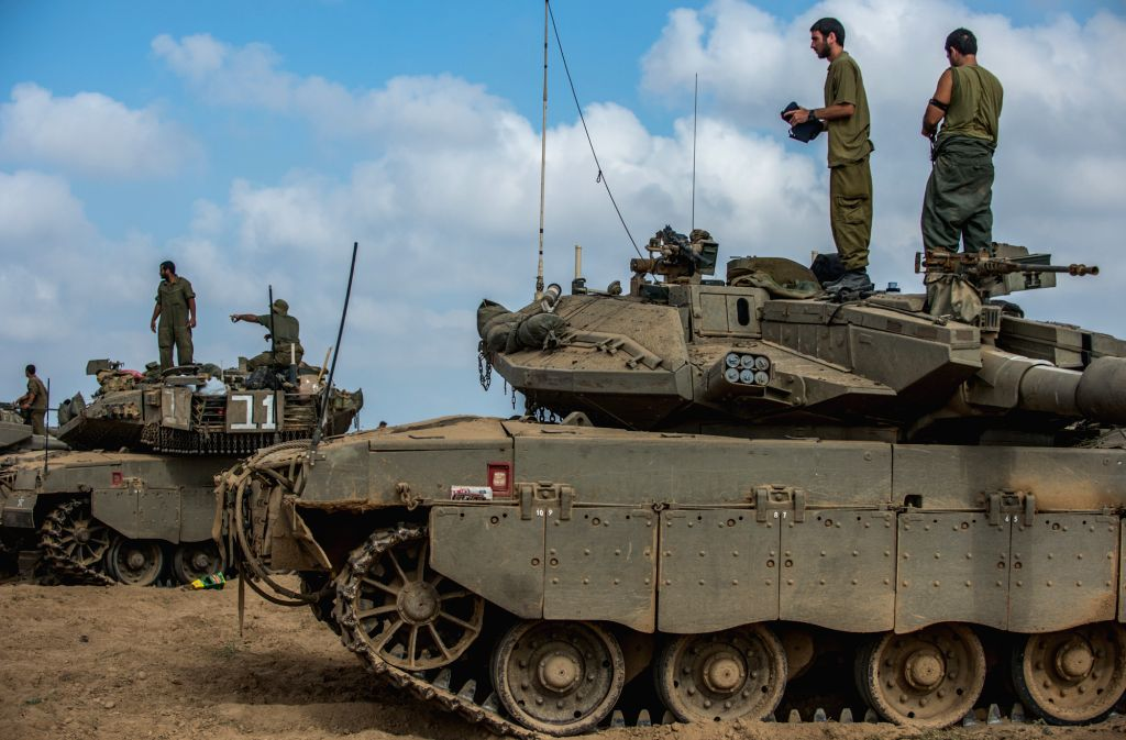 Israeli soldiers work on armored vehicles in southern Israel bordering the Palestinian Gaza Strip July 24, 2014, the 17th day of Operation Protective Edge. ...