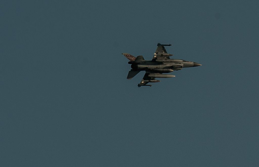 An Israeli F-16 jet fighter flies over Ashdod, a south Israeli city bordering the Gaza Strip, on July 8, 2014. Israel's security cabinet decided on Tuesday to ..