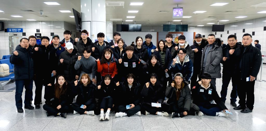 South Korea: A group of South Korean skiers raise their fists in a show of solidarity at Yangyang Airport on South Korea's east coast on Jan. 31, 2018, before departing for Kalma Airport in North ...
