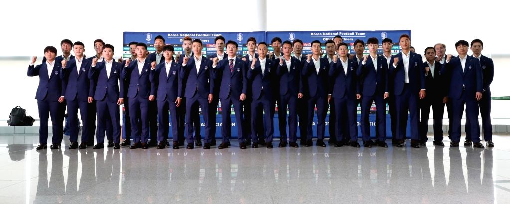 South Korea men's national football team poses for a group photo at Incheon International Airport, west of Seoul, on June 3, 2018, before leaving for Austria for their pre-World Cup training ...