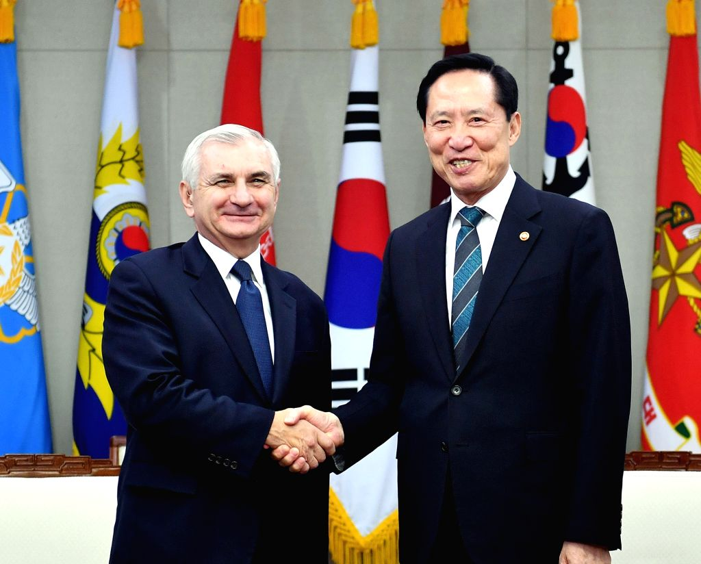 South Korea's Defense Minister Song Young-moo (R) shakes hands with visiting U.S. Sen. Jack Reed before a meeting at his office in Seoul on Oct. 11, 2017, in this photo provided by Seoul's ... - Song Young