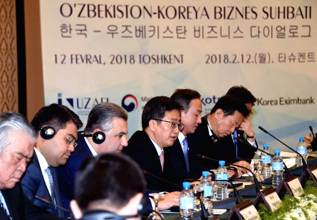South Korea's Deputy Prime Minister and Finance Minister Kim Dong-yeon (C) addresses a Korea-Uzbekistan business dialogue in Tashkent on Feb. 12, 2018, in this photo from Kim's ministry. ... - Kim Dong