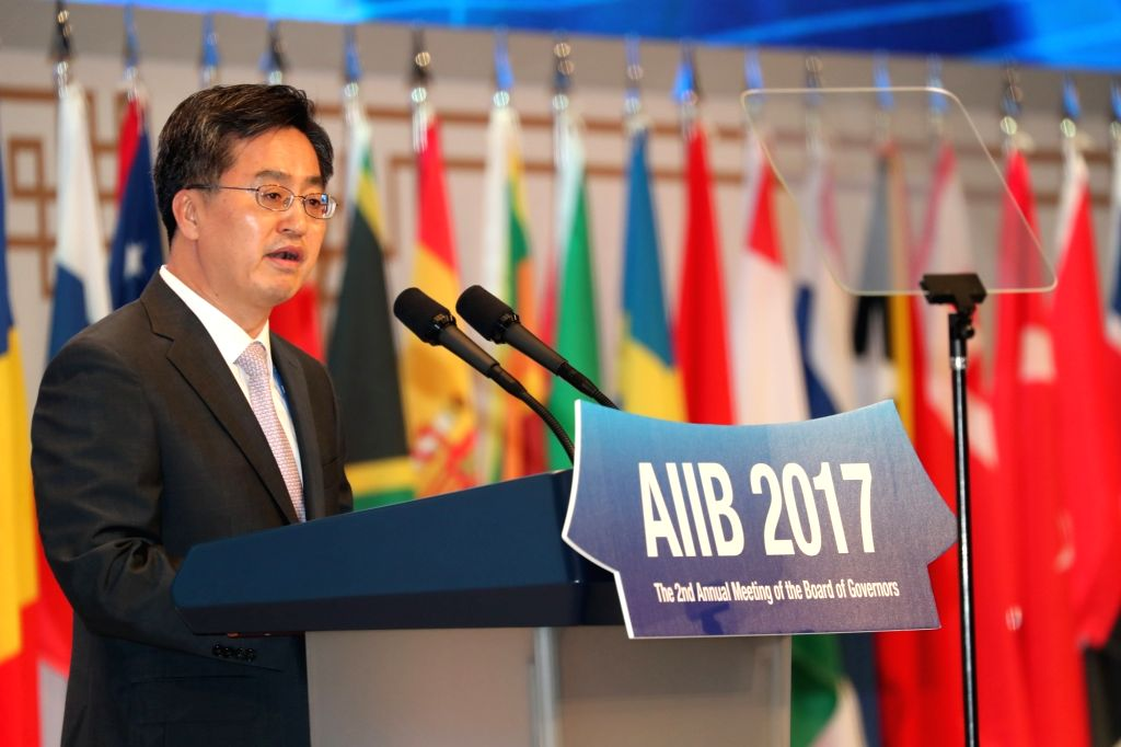 South Korea's Finance Minister Kim Dong-yeon delivers a keynote speech at the opening ceremony of the second annual meeting of the Asian Infrastructure Investment Bank (AIIB) at a convention center ... - Kim Dong