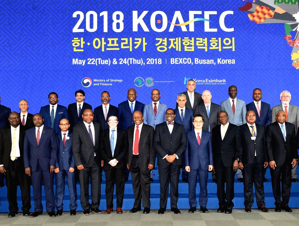 South Korea's Finance Minister Kim Dong-yeon (front, 4th from R) and other ministerial officials attending the African Development Bank annual meeting in Busan, 450 km southeast of Seoul, take ... - Kim Dong
