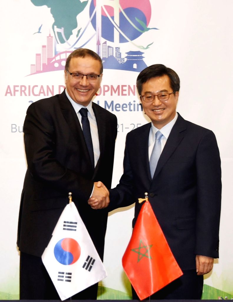 South Korea's Finance Minister Kim Dong-yeon (R) shakes hands with his Moroccan counterpart, Mohamed Boussaid, in Busan, 450 km southeast of Seoul, on May 23, 2018, in this photo released by ... - Kim Dong