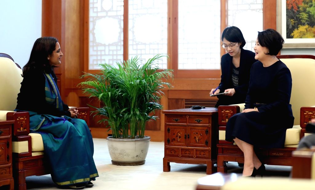 South Korea's first lady Kim Jung-sook (R) talks with Indian Ambassador to South Korea Sripriya Ranganathan during their meeting at the presidential office Cheong Wa Dae in Seoul on Nov. 1, ...