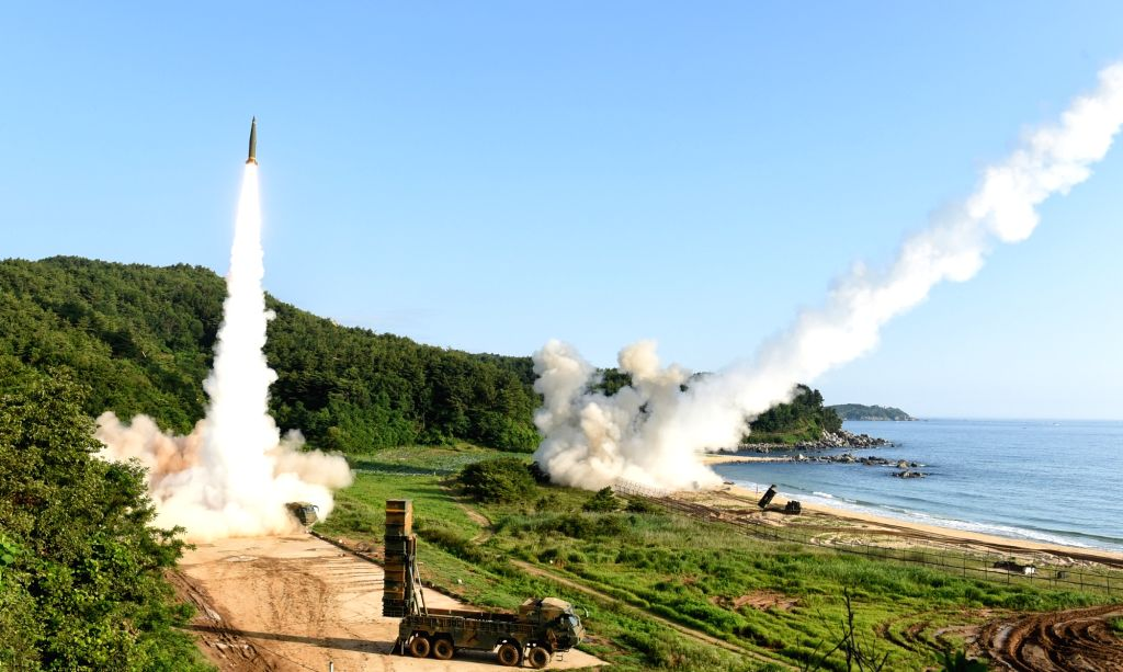 South Korea's Hyunmoo-2A (L) and the U.S. Eighth Army's ATACMS missiles are fired simultaneously during a joint missile exercise on the east coast on July 5, 2017. The drill comes a day after North ...