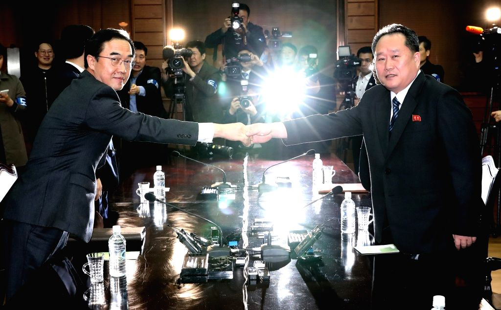South Korea's Unification Minister Cho Myoung-gyon (L) shakes hands with Ri Son-gwon, head of North Korea's agency in charge of affairs with the South, at the start of their talks at the truce ... - Cho Myoung