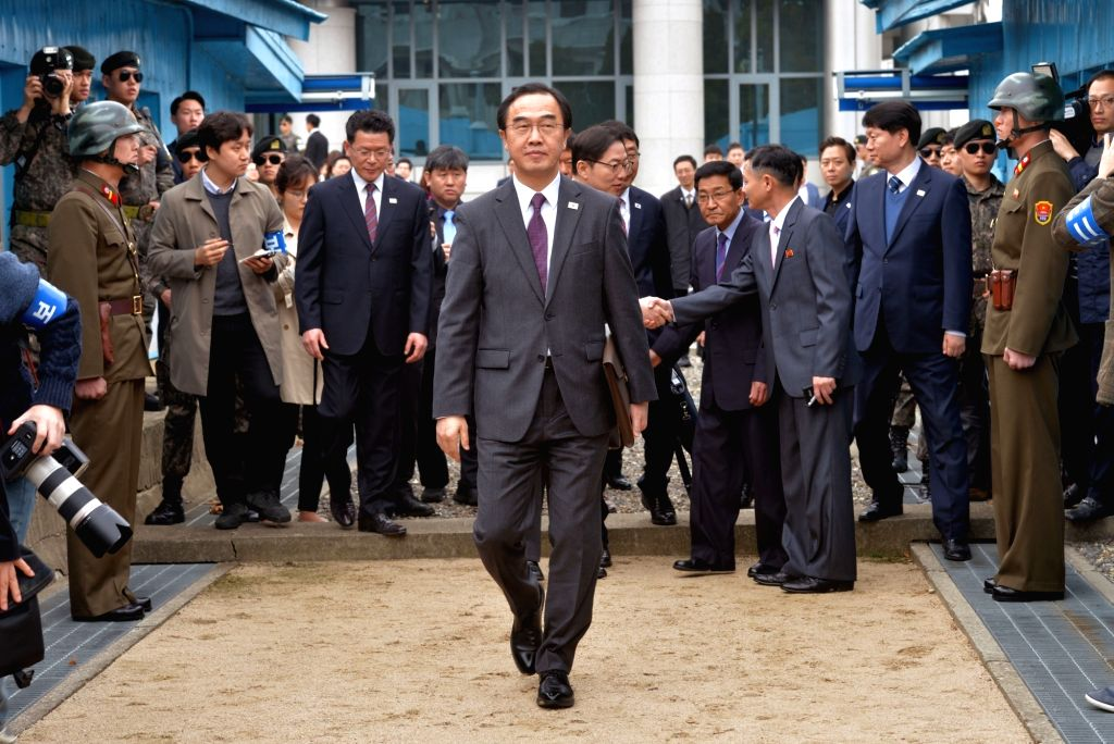 South Korea's Unification Minister Cho Myoung-gyon crosses the inter-Korean border on March 29, 2018, to go to the Tongilgak building on the North Korean side of the truce village Panmunjom ... - Cho Myoung