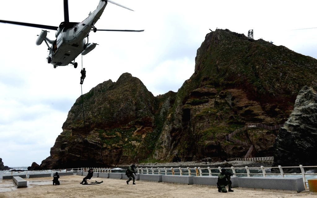 South Korea: This October 2013 file photo shows Navy and Korea Coast Guard special forces joining a military drill on South Korea's easternmost islets of Dokdo, over which Japan has repeatedly ...