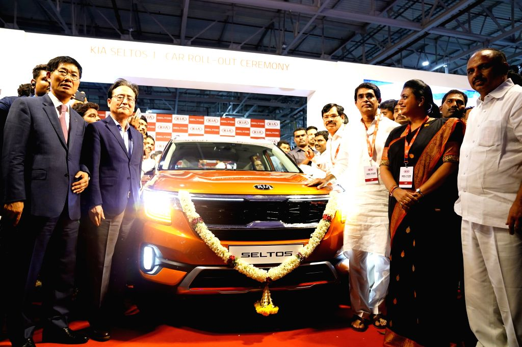 South Korean Ambassador to India Shin Bong-kil and Kia Motors India MD and CEO Kookhyun Shim roll out the production version of its first car for India, the Seltos at its state-of-the-art ...