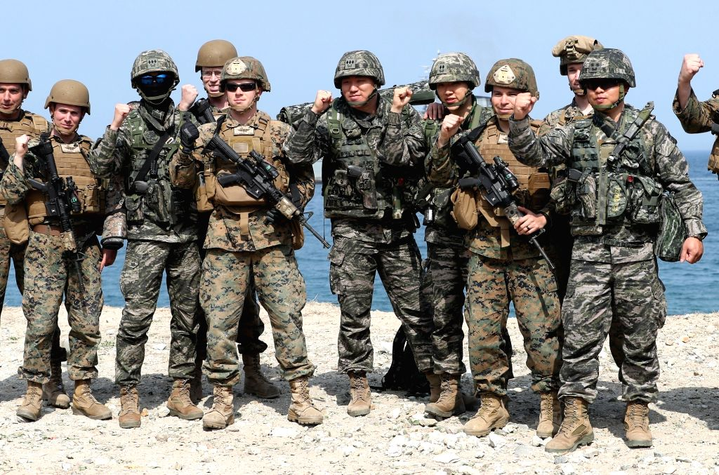 South Korean and American soldiers pose for a photo during a joint landing drill on the coast of Pohang, 374 km southeast of Seoul, on April 3, 2018.