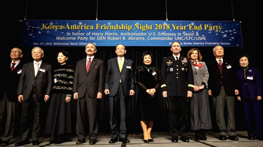South Korean and U.S. officials pose for a photo at the year-end Korea-America Friendship Night in Seoul on Dec. 11, 2018. Fourth from left is U.S. Ambassador to South Korea Harry Harris, and ...