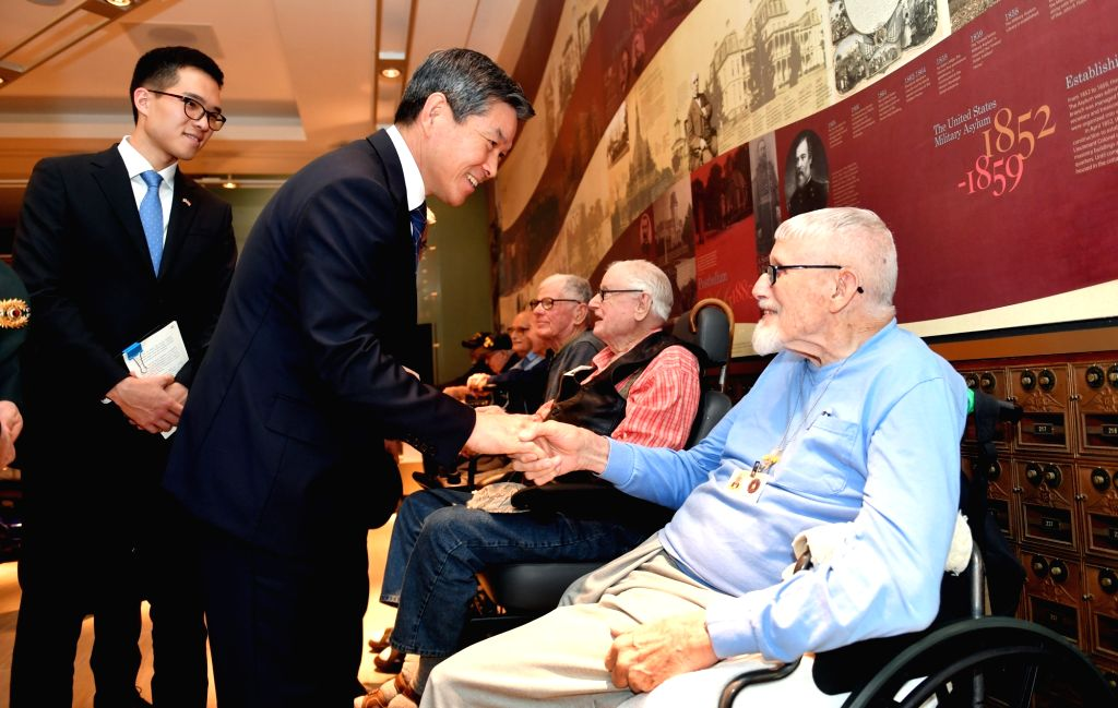 South Korean Defense Minister Jeong Kyeong-doo consoles U.S. Korean War veterans during a visit to a veterans center in Washington on Oct. 31, 2018, in this photo provided by the ... - Jeong Kyeong