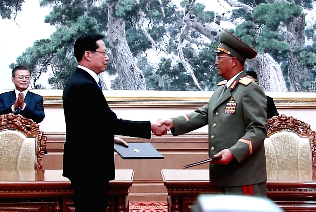 South Korean Defense Minister Song Young-moo (L) shakes hands with his North Korean counterpart No Kwang-chol after signing a military agreement in Pyongyang on Sept. 19, 2018, in this ... - Song Young