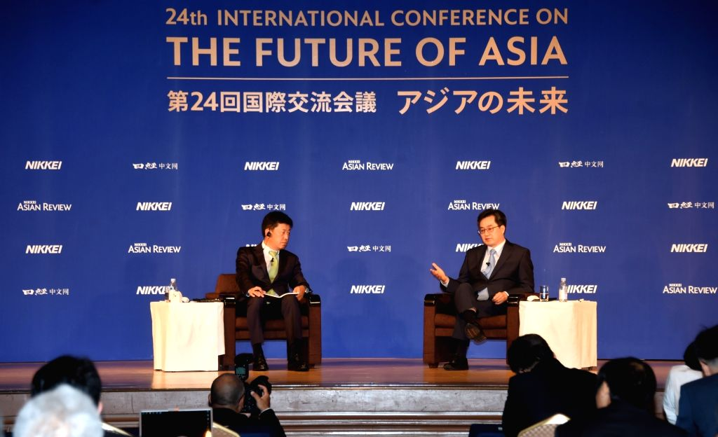"South Korean Finance Minister Kim Dong-yeon (R) speaks at a Nikkei-organized international conference on the ""Future of Asia"" in Tokyo on June 11, 2018, in this photo provided by the ... - Kim Dong"
