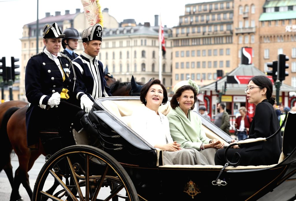 South Korean first lady Kim Jung-sook (L) and Swedish Queen Silvia take a carriage ride to the Stockholm Royal Palace on June 14, 2019, to attend a welcoming ceremony for South Korean ...