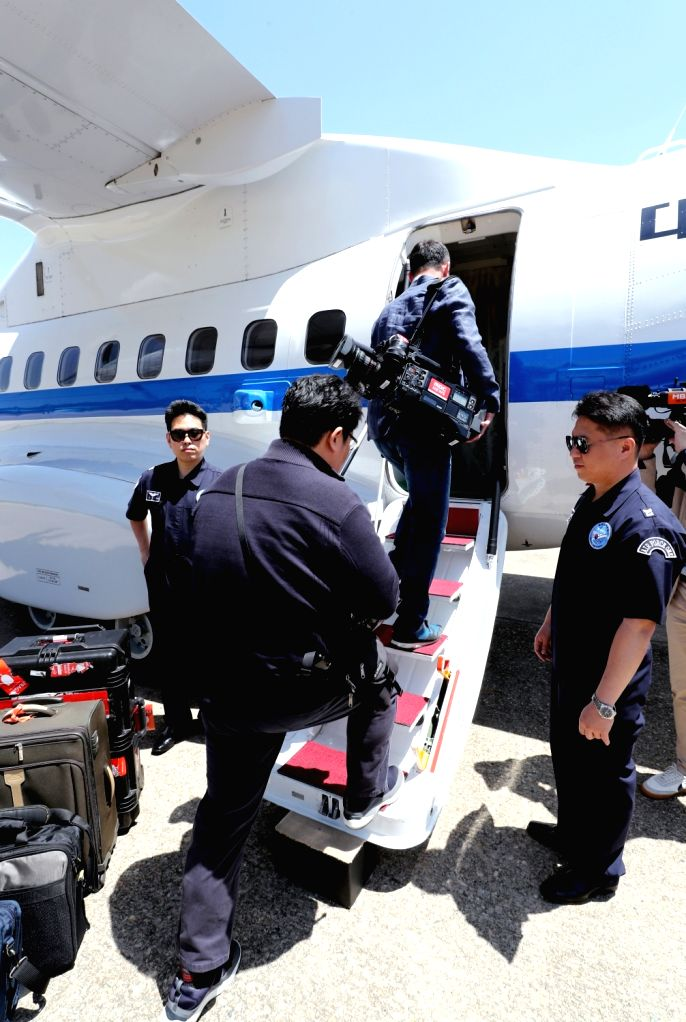 South Korean journalists board a plane at Seoul Airport, just southeast of Seoul, on May 23, 2018, to go to North Korea where they will cover the dismantlement of the North's key nuclear test ...