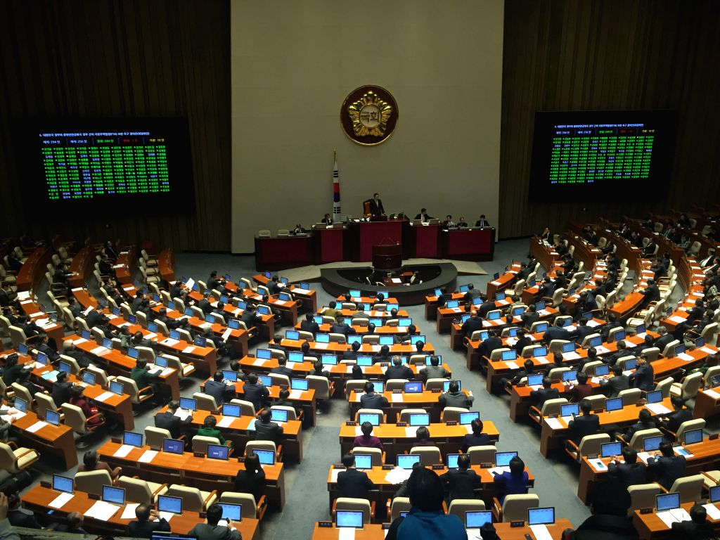 South Korean lawmakers pass a ratification bill on the China-South Korea free trade accord, at the National Assembly in Seoul, South Korea, Nov. 30, 2015. South ...