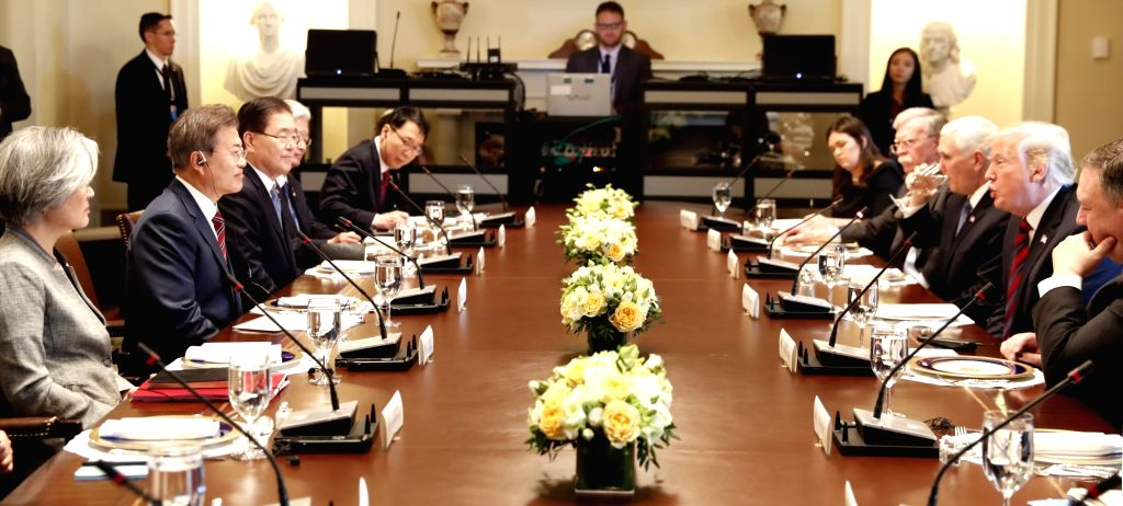 South Korean President Moon Jae-in (2nd from L) and U.S. President Donald Trump (2nd from R) hold talks during a meeting at the White House in Washington on May 22, 2018.