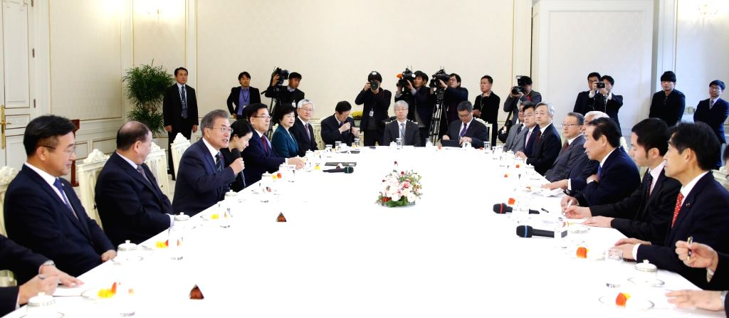 South Korean President Moon Jae-in (3 from L) speaks in a meeting with Japanese members of the South Korea-Japan Parliamentarians' Union at the presidential office in Seoul on Dec. 14, 2018. ...