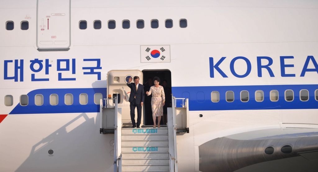 South Korean President Moon Jae-in arrives along with his wife Kim Jung-sook, in New Delhi on July 8, 2018.