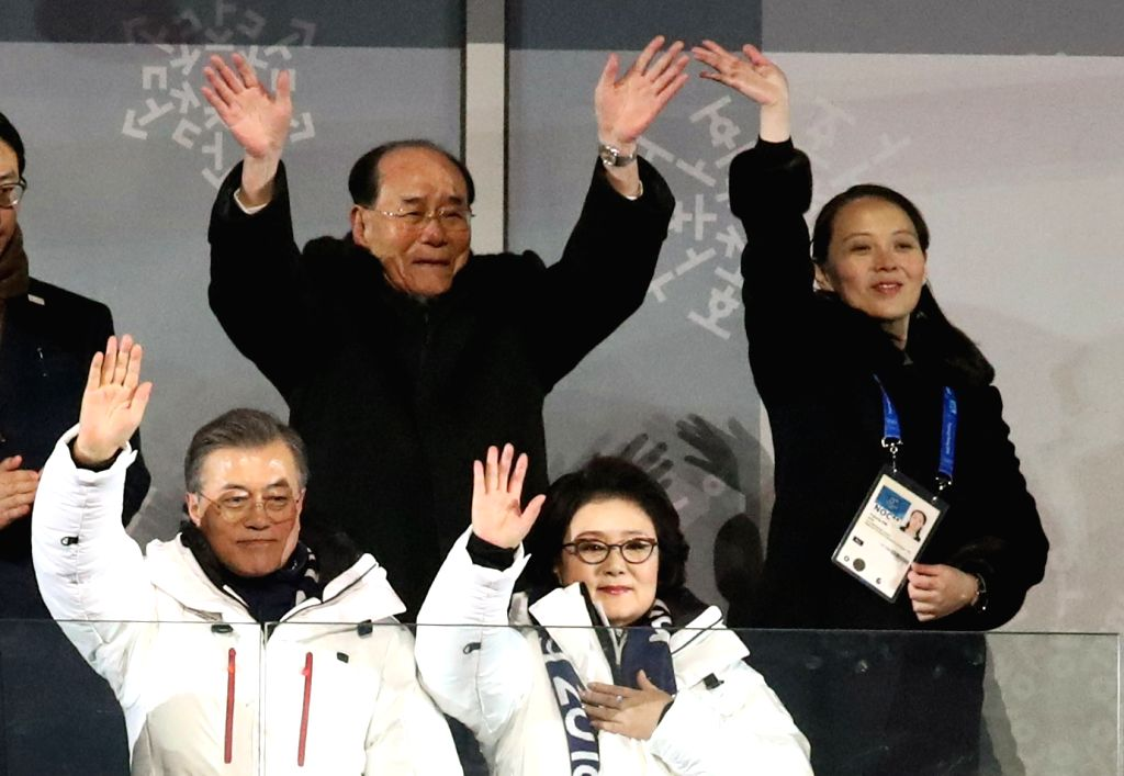 South Korean President Moon Jae-in (front row, L) and first lady Kim Jung-sook wave as South and North Korean athletes march under one flag during the opening ceremony of the 2018 Winter ...