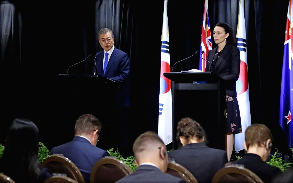 South Korean President Moon Jae-in (L) and New Zealand Prime Minister Jacinda Ardern hold a joint press conference to announce the outcome of their summit in Auckland on Dec. 4, 2018. - Jacinda Ardern