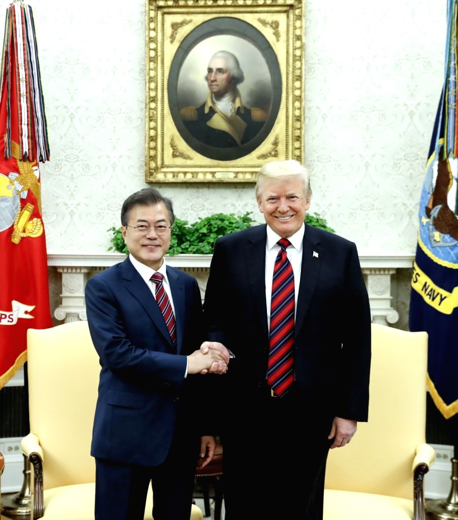 South Korean President Moon Jae-in (L) and U.S. President Donald Trump shake hands during a meeting at the White House in Washington on May 22, 2018. .