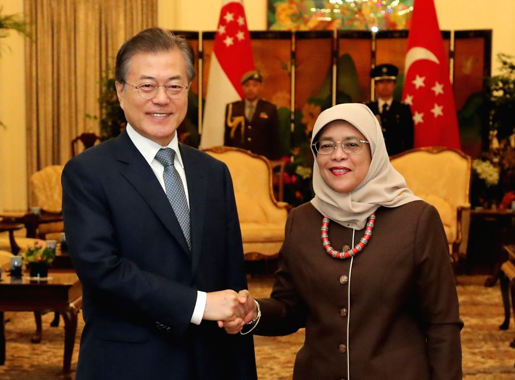 South Korean President Moon Jae-in (L) meets Singaporean President Halimah Yacob at the Istana presidential office in Singapore on July 12, 2018. Moon arrived in the Asian country the ...