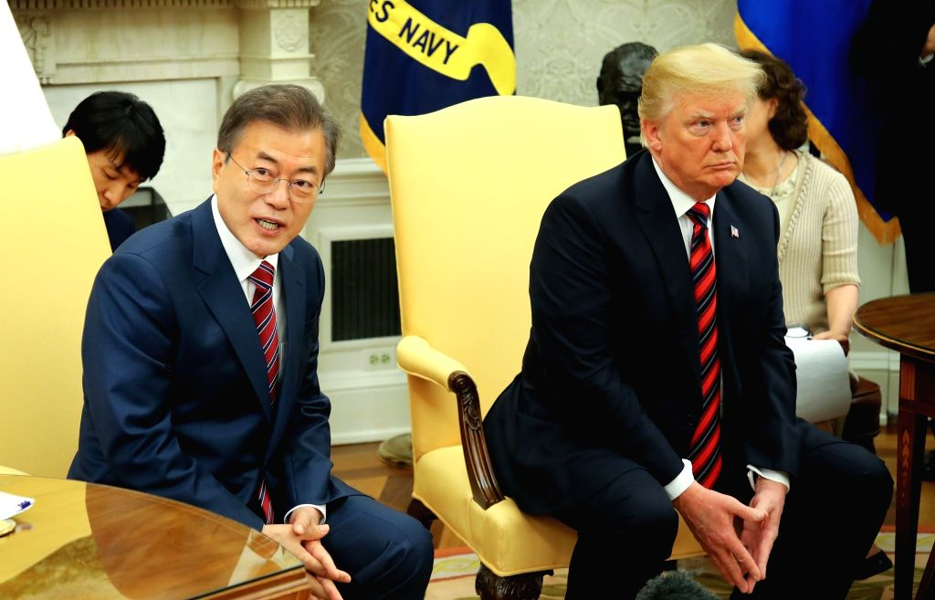 South Korean President Moon Jae-in (L) responds to reporters' questions during his meeting with U.S. President Donald Trump at the White House in Washington on May 22, 2018.