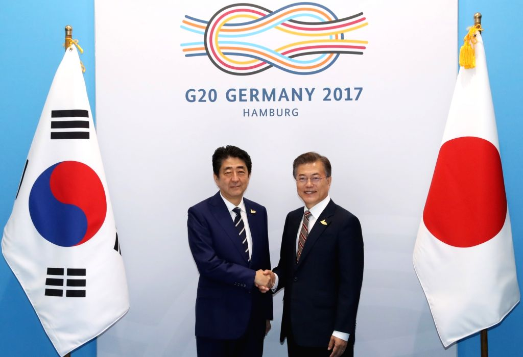 South Korean President Moon Jae-in (R) and Japanese Prime Minister Shinzo Abe pose for a photo prior to their talks in Hamburg, Germany, on July 7, 2017. The leaders met on the sidelines of ... - Shinzo Abe