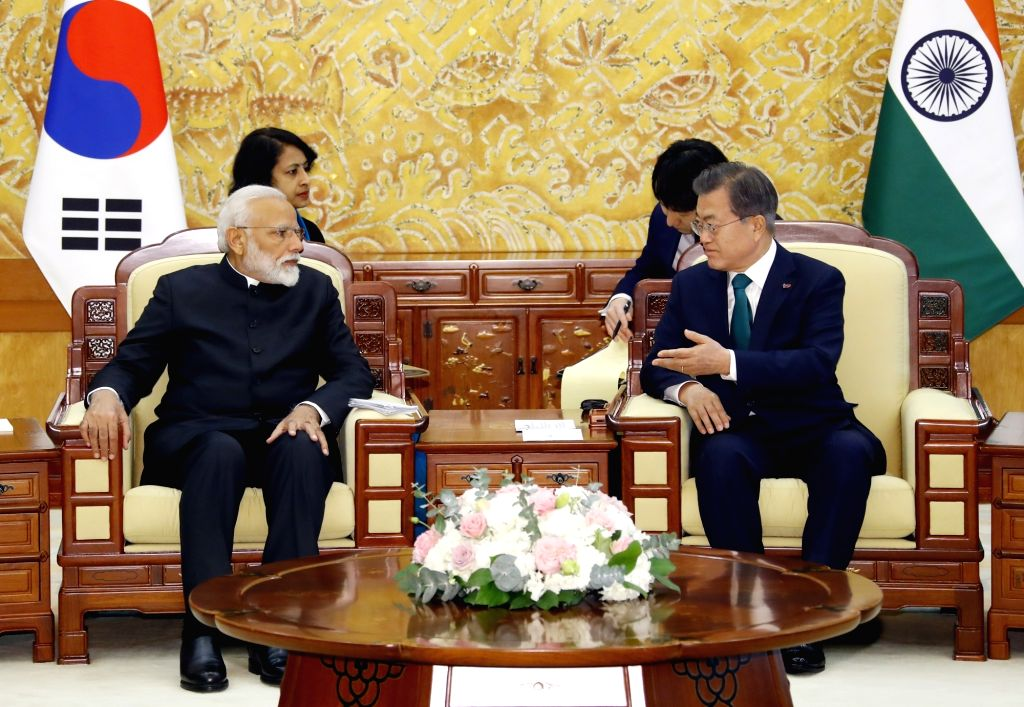 South Korean President Moon Jae-in (R) holds a summit meeting with Indian Prime Minister Narendra Modi at the presidential office Cheong Wa Dae in Seoul on Feb. 22, 2019. - Narendra Modi
