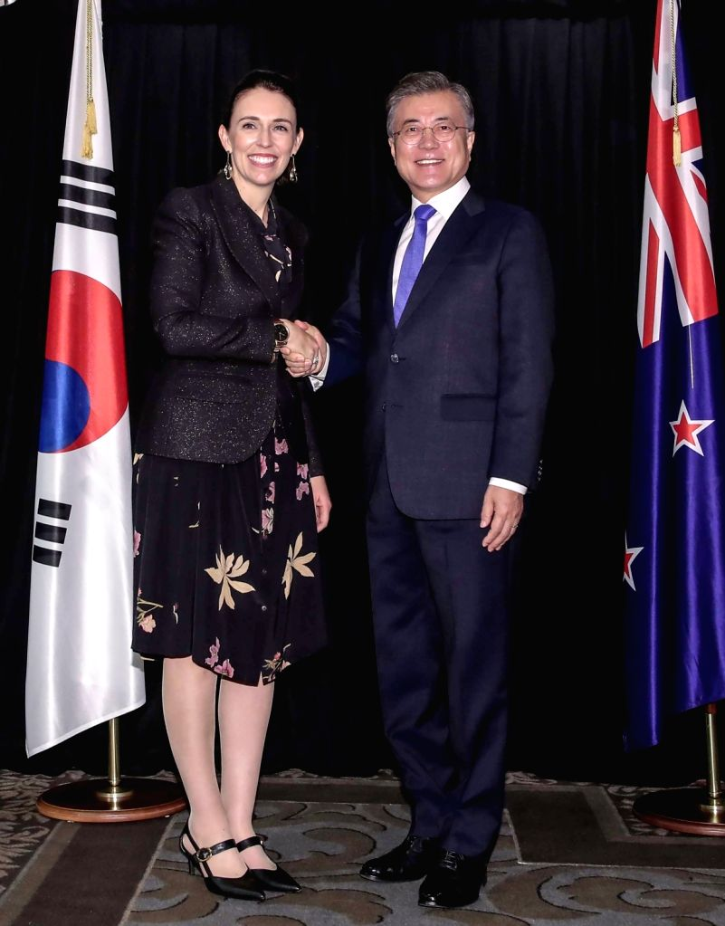 South Korean President Moon Jae-in (R) shakes hands with New Zealand Prime Minister Jacinda Ardern before the start of their summit in Auckland on Dec. 4, 2018. - Jacinda Ardern