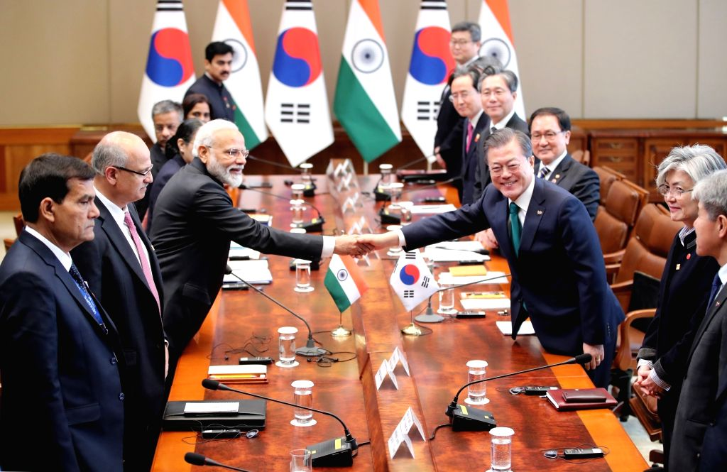 South Korean President Moon Jae-in (R) shakes hands with Indian Prime Minister Narendra Modi at the start of an extended summit at the presidential office Cheong Wa Dae in Seoul on Feb. 22, ... - Narendra Modi