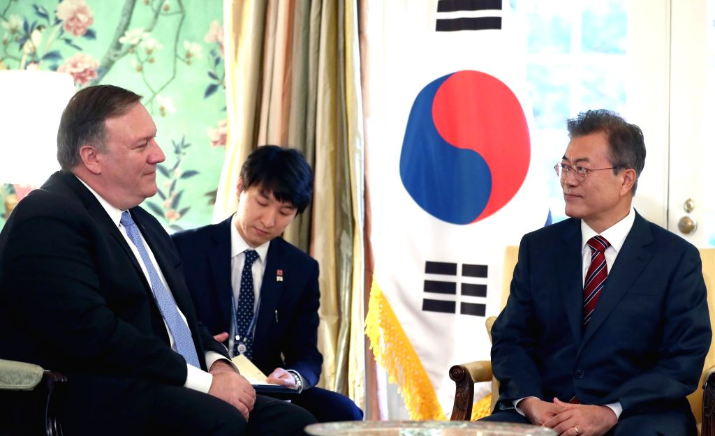 South Korean President Moon Jae-in (R) talks with U.S. Secretary of State Mike Pompeo during their meeting in Washington on May 22, 2018. Moon arrived in Washington the previous day to ...