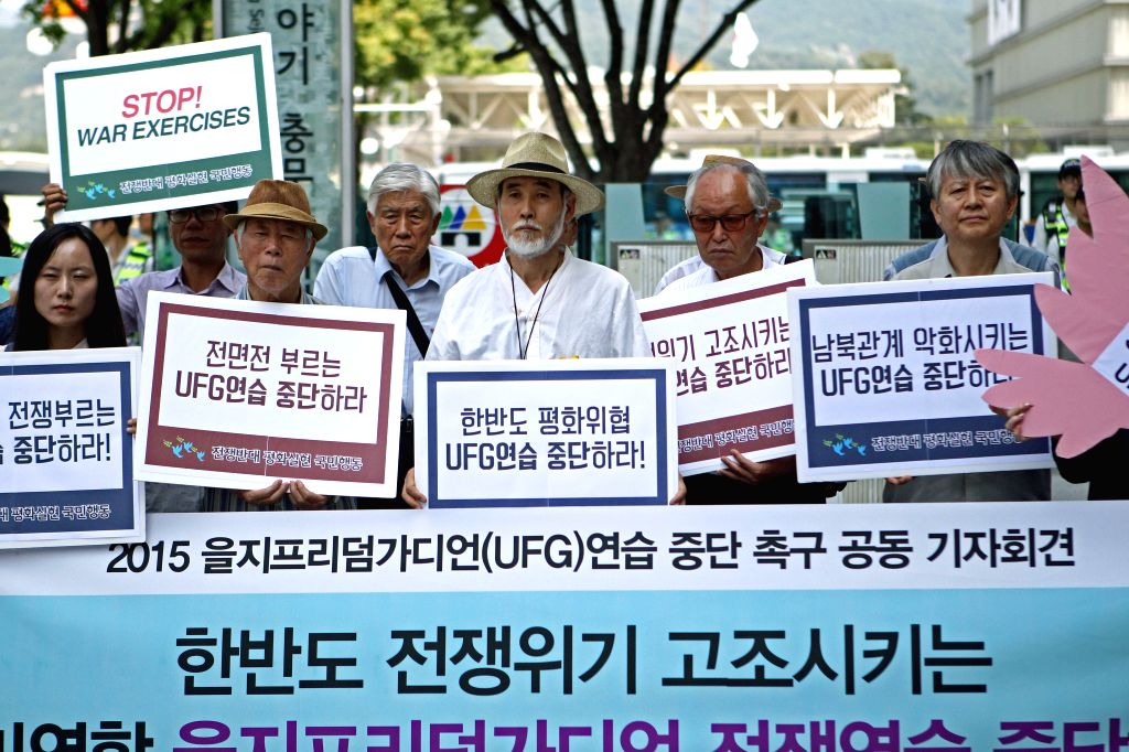 South Korean protesters hold a rally demanding to stop the joint military exercise, Ulchi Freedom Guardian (UFG), between the U.S. and South Korea near the U.S. ...