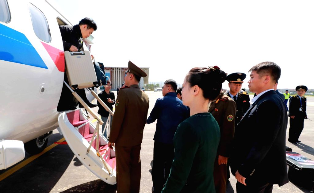 South Korean reporters arrive at an airport in North Korea's eastern port city of Wonsan on May 23, 2018, in this pool photo to cover the dismantlement of North Korea's nuclear test facilities ...