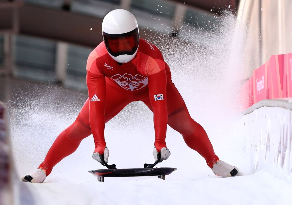 South Korean skeleton slider Kim Ji-soo crosses the finish line in the first run of the men's skeleton at the PyeongChang Winter Games at Olympic Sliding Centre in Pyeongchang, 180 ...