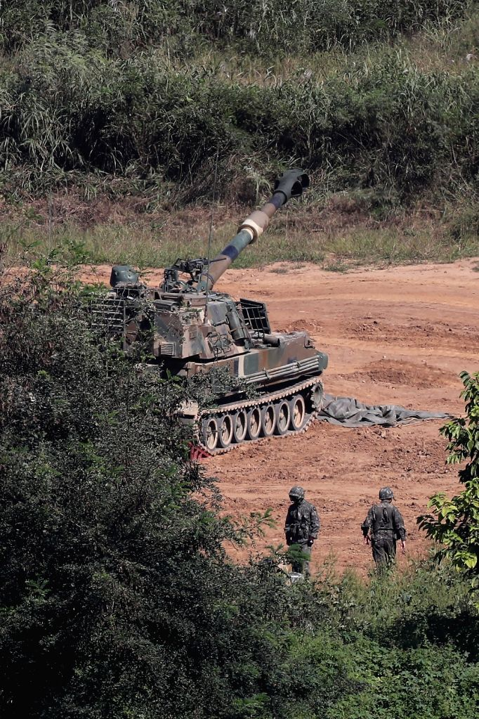 South Korean soldiers move around a K-9 self-propelled howitzer on the western section of the inter-Korean border in Paju, north of Seoul, on Sept. 15, 2017. The North earlier in the day fired what ...