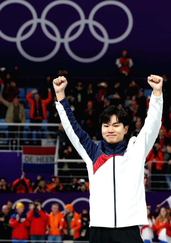 South Korean speed skater Kim Min-seok celebrates during the venue ceremony after winning bronze in the men's 1,500 meter event of the PyeongChang Winter Olympics at the Gangneung Oval ...