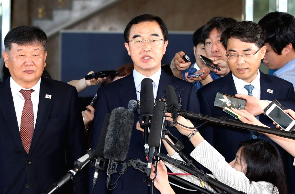 South Korean Unification Minister Cho Myoung-gyon speaks to reporters as he leaves Seoul for high-level talks with North Korea at the truce village of Panmunjom on June 1, 2018. The ... - Cho Myoung