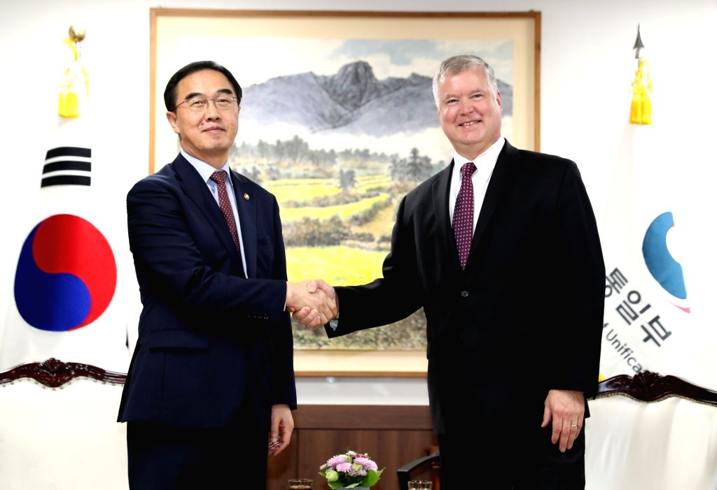 South Korean Unification Minister Cho Myoung-gyon (L) shakes hands with Stephen Biegun, the new U.S. representative on North Korea policy, ahead of their talks in Seoul on Sept. 11, 2018. The ... - Cho Myoung