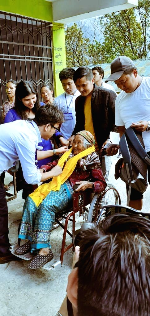 South Sikkim: Sumitra Rai, 107, the oldest voter of Sikkim arrives at a polling station to cast vote for Lok Sabha election, in South Sikkim, on April 11, 2019. - Sumitra Rai