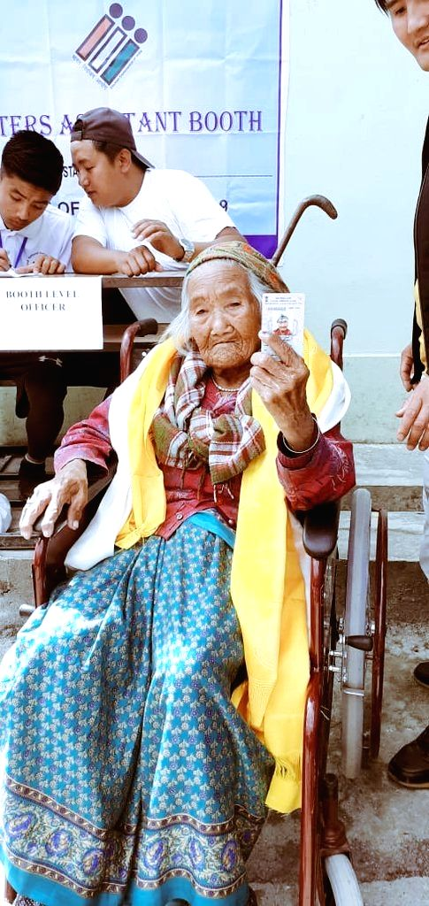 South Sikkim: Sumitra Rai, 107, the oldest voter of Sikkim shows her inked finger after casting vote for Lok Sabha election at a polling station, in South Sikkim, on April 11, 2019. - Sumitra Rai