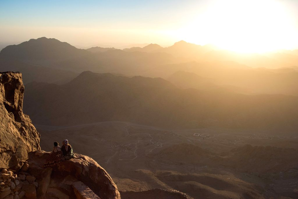 SOUTH SINAI, Oct. 10, 2017 - Tourists enjoy the sight of sunrise on the Sinai Mount in South Sinai Governorate, Egypt, Oct. 9, 2017.
