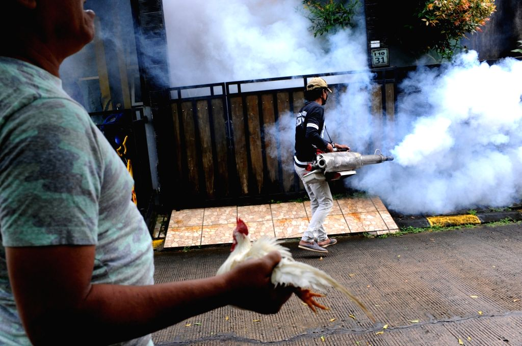 SOUTH TANGERANG, Feb. 17, 2019 - A worker sprays anti-mosquito fog at Cendana Residence in South Tangerang, Indonesia, Feb. 17, 2019. Controlling the number of the adult and larval population of the ...