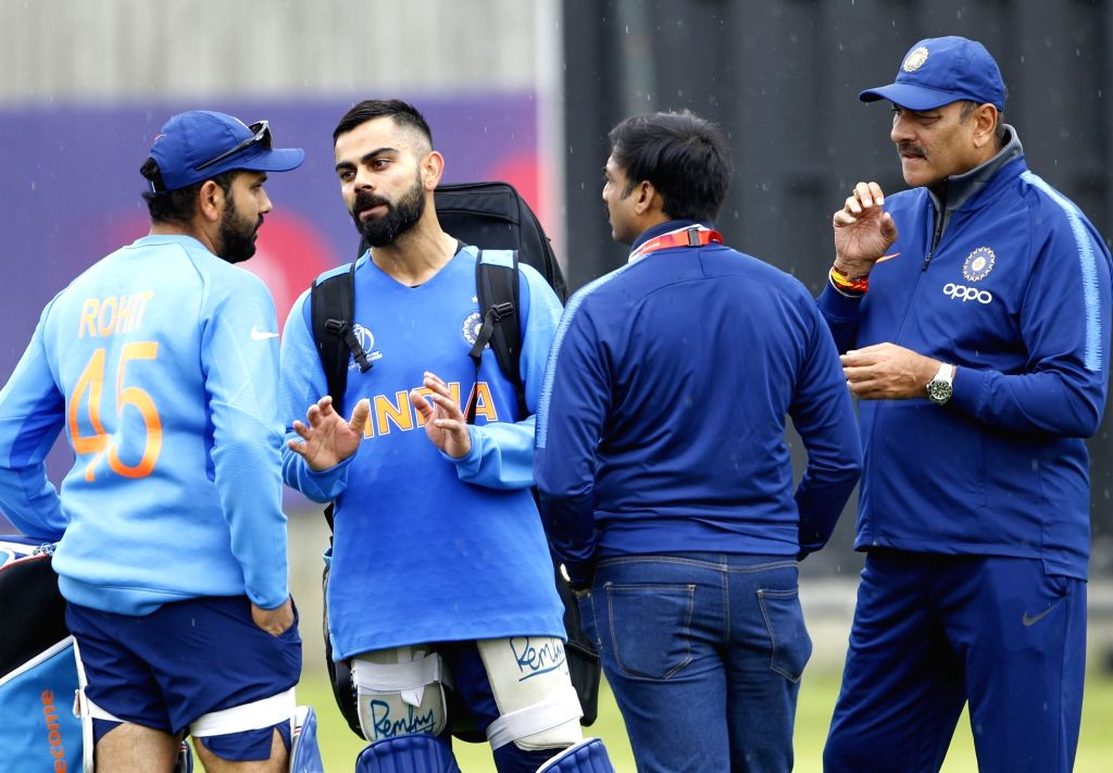 Southampton: India's captain Virat Kohli and Coach Ravi Shastri with Rohit Sharma during a practice session ahead of a World Cup 2019 match against Afghanistan at the Hampshire Bowl in Southampton, England on June 19, 2019. (Photo: Surjeet Yadav/IANS - Virat Kohli, Rohit Sharma and Surjeet Yadav