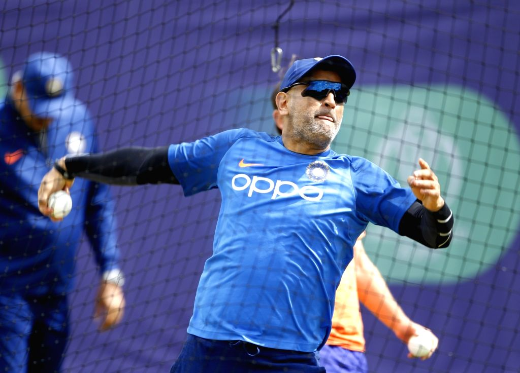 Southampton: India's MS Dhoni during a practice session ahead of a World Cup 2019 match against Afghanistan at the Hampshire Bowl in Southampton, England on June 20, 2019. (Photo: Surjeet Yadav/IANS) - MS Dhoni and Surjeet Yadav