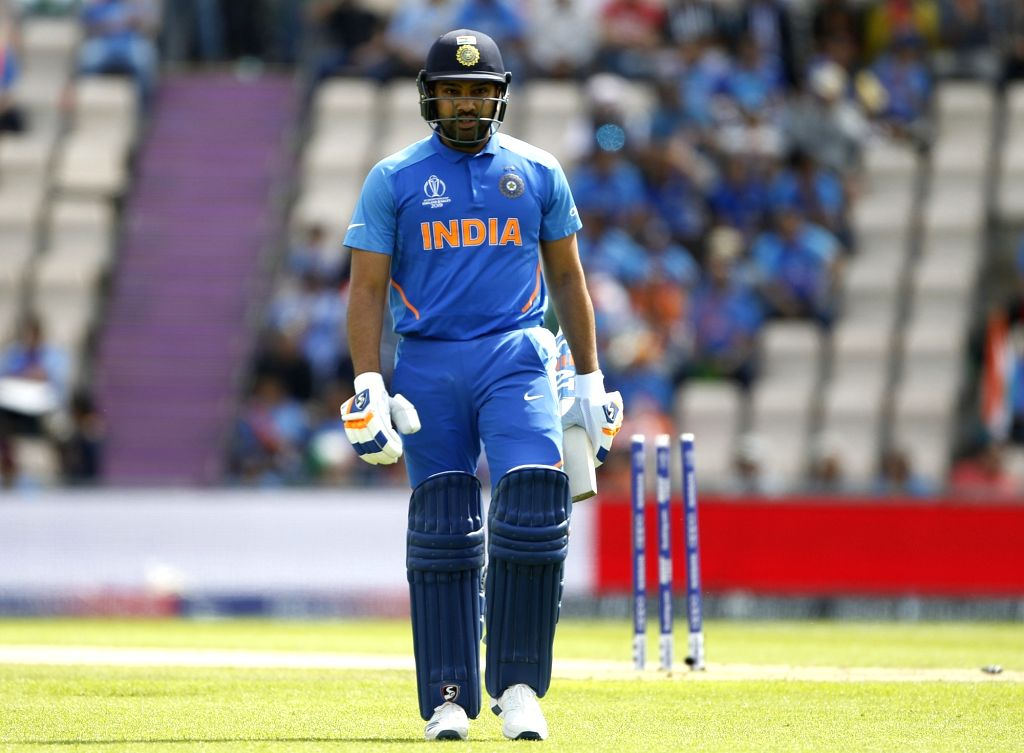 Southampton: India's Rohit Sharma walks back to the pavilion during the 28th match of World Cup 2019 between India and Afghanistan at the The Rose Bowl in Southampton, England on June 22, 2019. (Photo: Surjeet Yadav/IANS) - Rohit Sharma and Surjeet Yadav